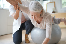 Senior Woman Exercising With H...