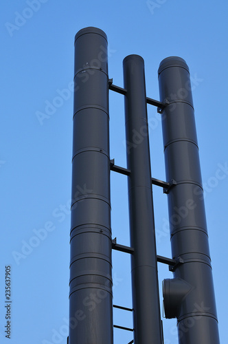 Canvas high chimney pipes of dark metal