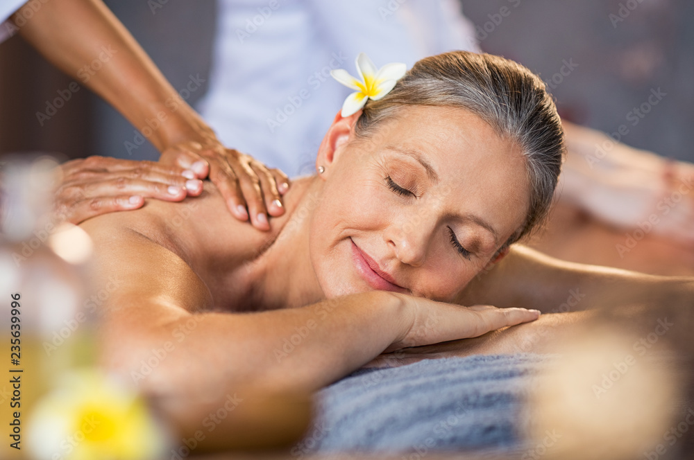 Fototapeta Woman receiving massage at spa