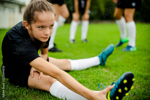 Girls stretching on the field