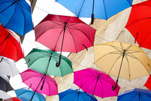 Colorful Umbrellas On A Background Of Blue Sky