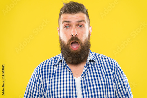 Fotografie, Obraz  Man bearded hipster with sneezing face open eyes close up yellow background