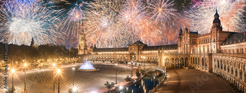 Beautiful fireworks above Spain Square on sunset, Seville