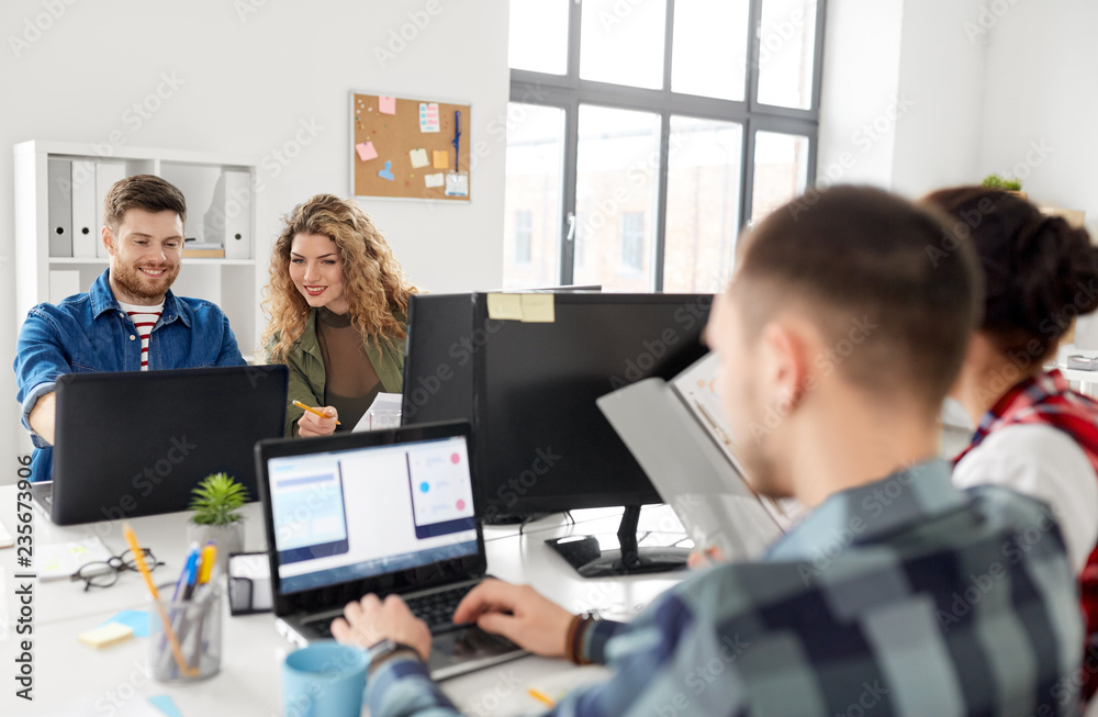Fototapeta business, technology and people concept - creative team or designers working on user interface at office