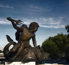 Straddling The Fish Whale (leviathan) A Young Man With A Trident. Ancient Bronze Sculpture, Champs Elysees, Paris