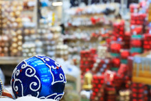 Blurred Image Of Christmas And New Year Decorations In The Store, Blue Ball And Balls In Boxes, Defocused Background Of The Shopping Center, Winter Concept