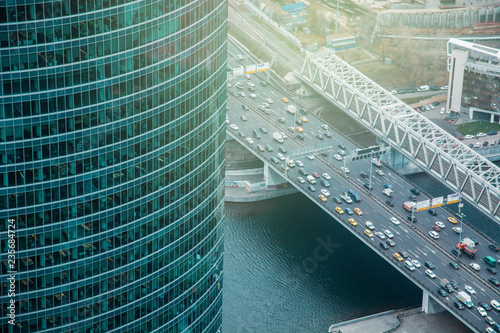 Fotobehang Stad gebouw Aerial view from Federation Tower Moscow City. View to highway. Urban pattern. Night and sunset in city.
