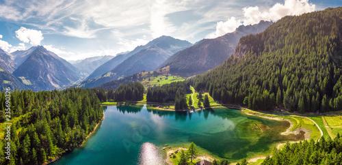Fotobehang Meer / Vijver Arnisee with Swiss Alps. Arnisee is a reservoir in the Canton of Uri, Switzerland, Europe