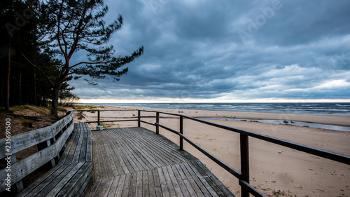 A view of the wooden walkway on the Baltic seacoast on a cloudy autumn day, Latvia