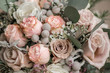 Wedding bouquet in shades of dusty rose, white, green, beige, pink and purple. Beautiful and delicate bridal bouquet.