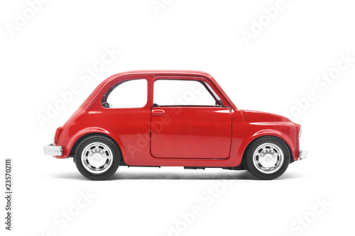 Keuken foto achterwand Vintage cars red retro car toy model isolated on white
