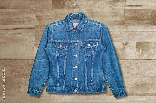Fotografering  Denim jeans jacket on hanger isolated on white