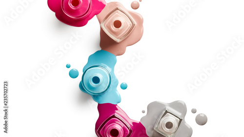 Photo sur Toile Manicure Spilled nail polish isolated on white background
