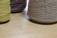 Close Up Of Cotton Cone Yarn, Thread Spool On Wooden Background