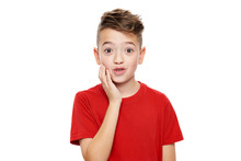 Adorable Young Boy In Shock, Isolated Over White Background. Shocked Child Looking At Camera In Disbelief. Shock, Amazement, Surprise Concept.