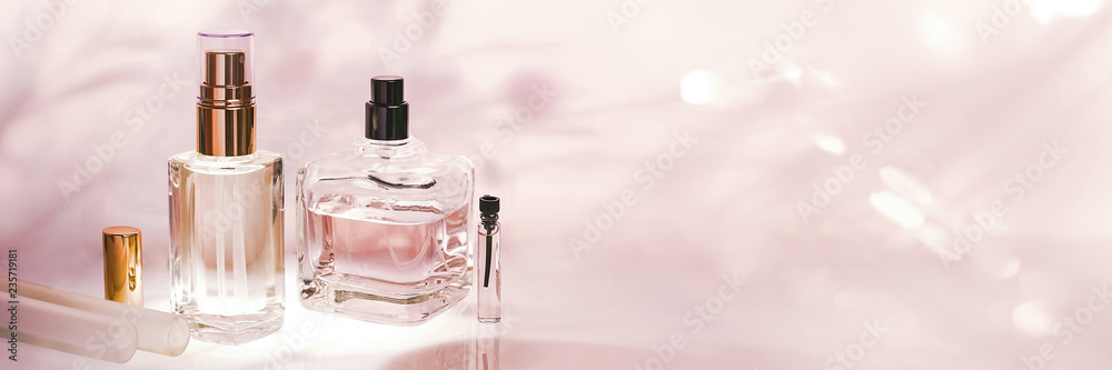 Fototapety, obrazy: Different perfume bottles and sampler on a pink floral background. Perfumery collection, cosmetics Banner