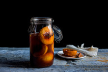 Close Up Of Pickled Peaches In...