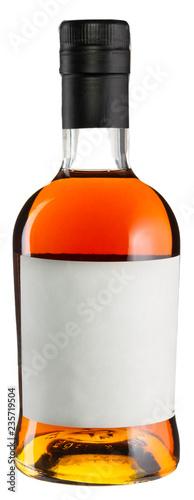 Photo Whiskey bottle with blank label isolated on white.