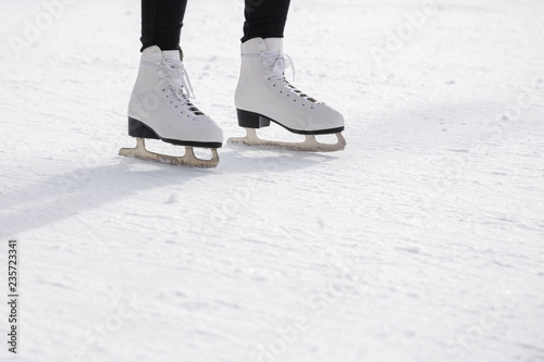 Young woman ice skating on ice rink