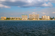 Fort Myers Beach Florida Holiday Vacation Destination, Coast Of Estero Island With Beachfront Hotel Resort Buildings, View From The Boat