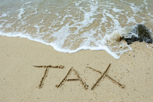 Tax Text Written On The Sand B...