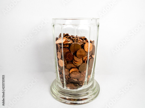 Fotografía  Cup with large amount of coins