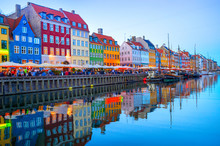 Illuminated Nyhavn Embankment By Canal