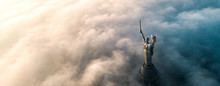 Aerial View Of The Monument Motherland, Shrouded In Thick Fog. Historical Sights Of Ukraine.