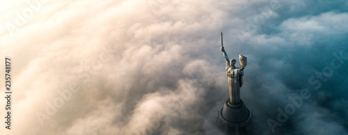 Fotografie, Obraz  Aerial view of the Monument Motherland, shrouded in thick fog