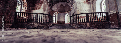 Foto op Plexiglas Oude gebouw Inside Interior of an old Abandoned Church in Latvia, Galgauska - light Shining Through the Windows