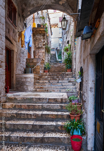 Wall Murals Narrow alley Through the streets of the old historic part of the fortress city of Dubrovnik Croatia. Stone stairs leading up to the upper part of the city