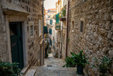 Fototapeta Uliczki - Medieval narrow street in old town of Dubrovnik, Croatia