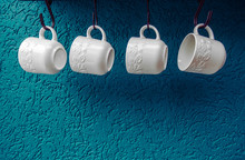 Coffee Cups Hanging On Hooks Of Blue Kitchen Wall Modern Interior