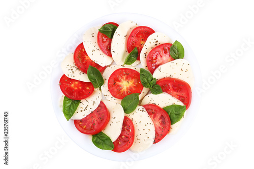 Mozzarella, tomatoes and basil leafs on plate isolated on white background Wallpaper Mural