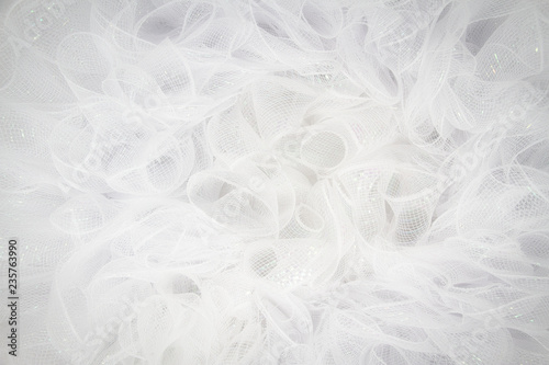 Fotografia, Obraz Pure white tulle fabric in an intricate frill that can be used as the background for bridal showers or baby invitations