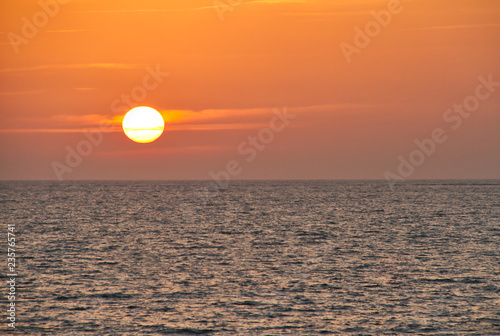 Fotografia, Obraz  The sun setting over the Atlantic Ocean as seen from Spain.