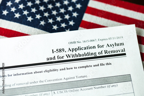 Photo Application for asylum to USA concept with application form and USA flag
