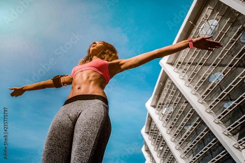 Fotografie, Obraz  Low angle of a beautiful fit woman
