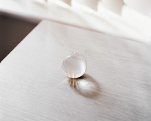 Glass Sphere On Table