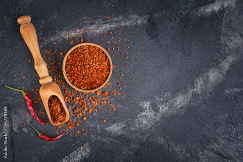 Foto op Plexiglas Hot chili peppers Top view of dry red chili pepper in wooden bowl and scoop