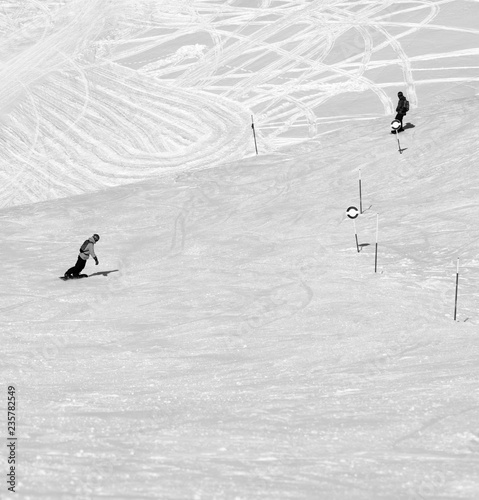 Two snowboarders downhill