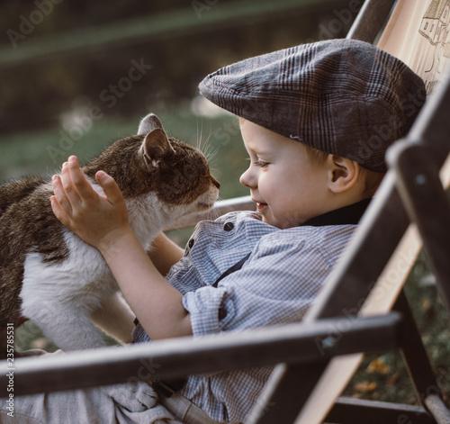 Poster Artist KB Cute, little boy hugging a cat