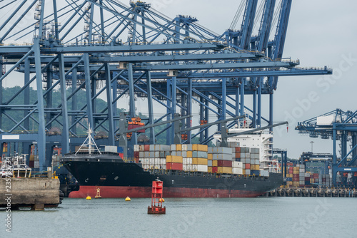 Foto op Plexiglas Antwerpen Container cranes loading a ship in port in Panama near the entrance to the Panama Canal.