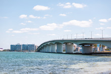 Sarasota, USA Beach In Florida City During Sunny Day, Cityscape, Bay, Buildings, And John Ringling Causeway Bridge