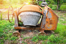 Old Concrete Mixer Machine At Construction Working Site