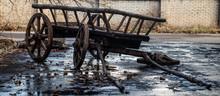 The Old Broken-down Cart In Th...