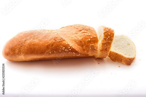 Fotografie, Obraz  Sliced fresh baguette isolated on white background