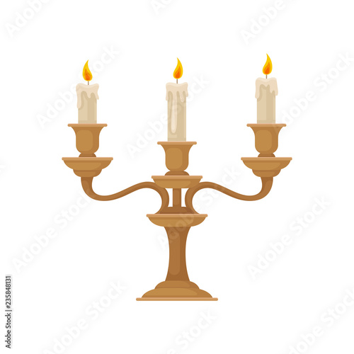 Leinwand Poster Candelabrum with three burning candles with melting wax, vintage bronze candlest