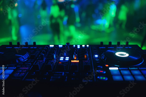 Fotografie, Obraz  DJ mixer controller panel for electronic music in night club