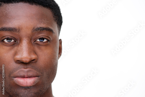 Fotografiet  Close up portrait of african american man staring